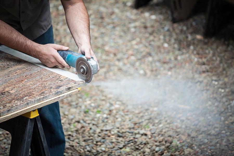 worker cutting slab